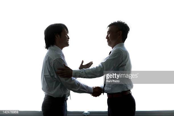 businessmen shaking hands in the office