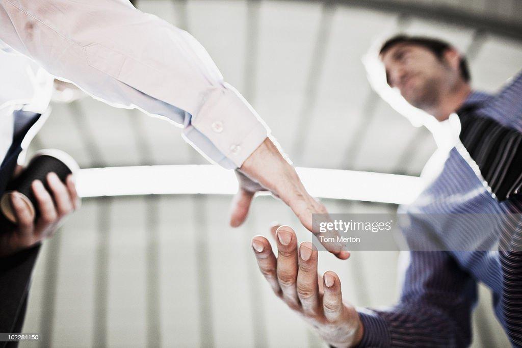 Businessmen shaking hands : Stock Photo