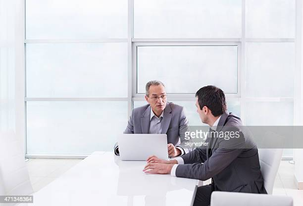 Businessmen sitting in the office and discussing on a meeting.