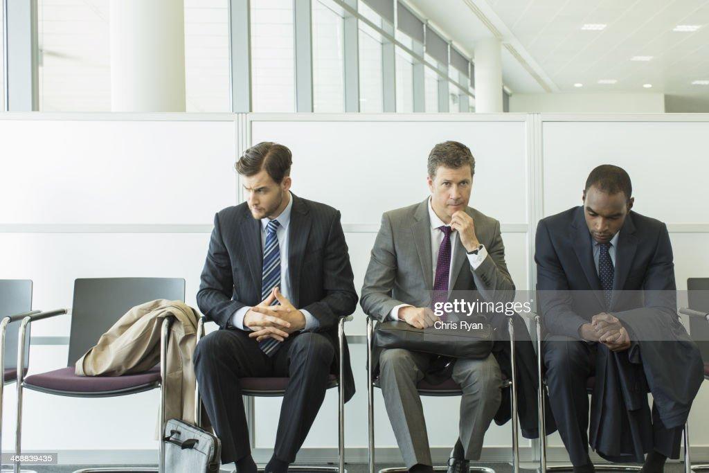 Businessmen sitting in waiting area