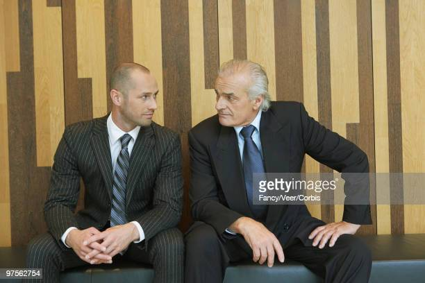 Businessmen sitting side by side