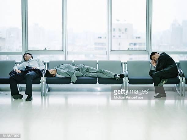 Businessmen Sleeping in Waiting Room