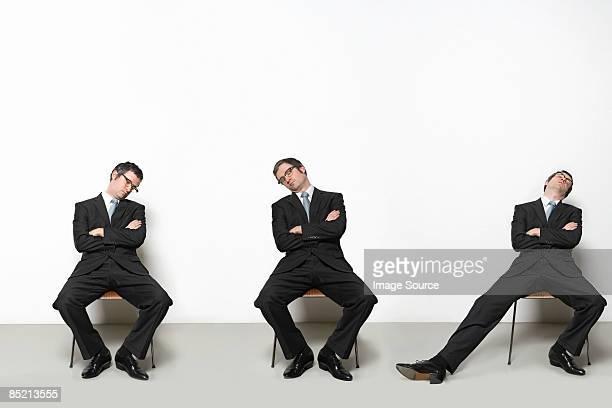 Businessmen sleeping