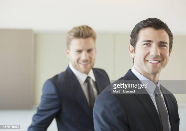 Businessmen smiling in office