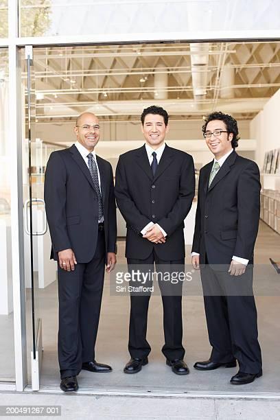 Businessmen standing at doorway of office