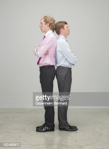 businessmen standing back to back : Stock Photo