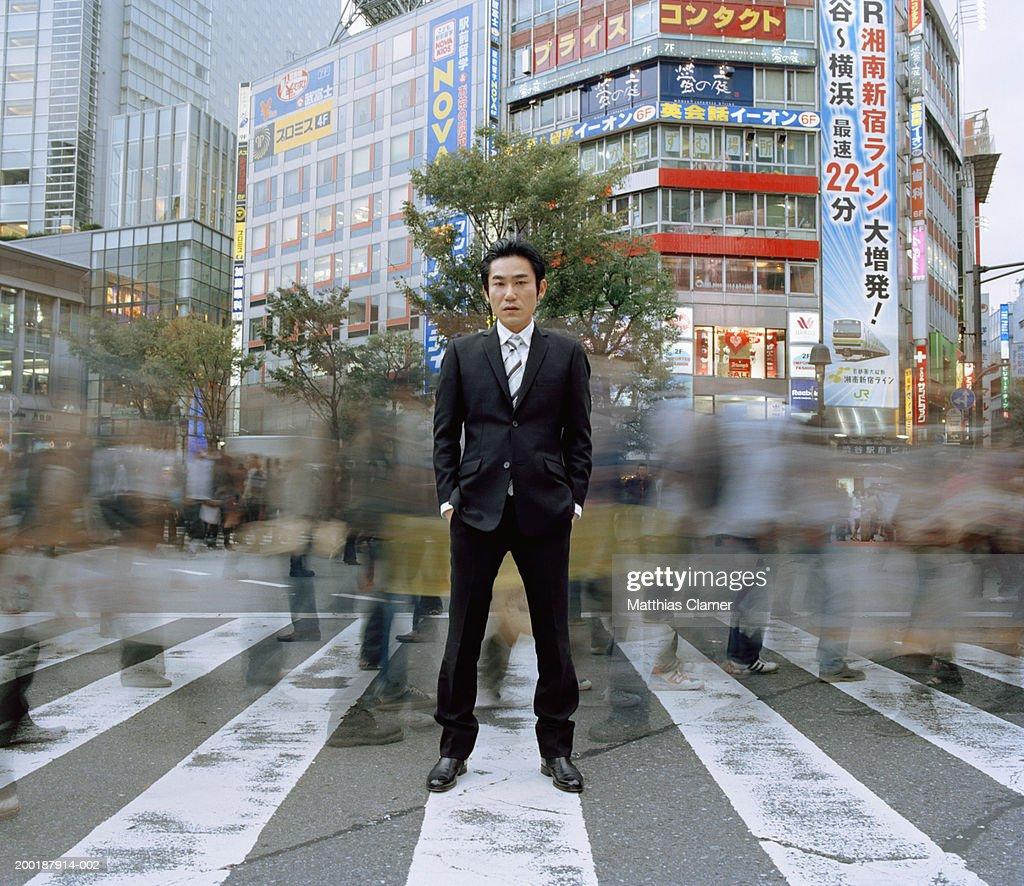 Businessmen standing in crosswalk (long exposure) : Stock Photo