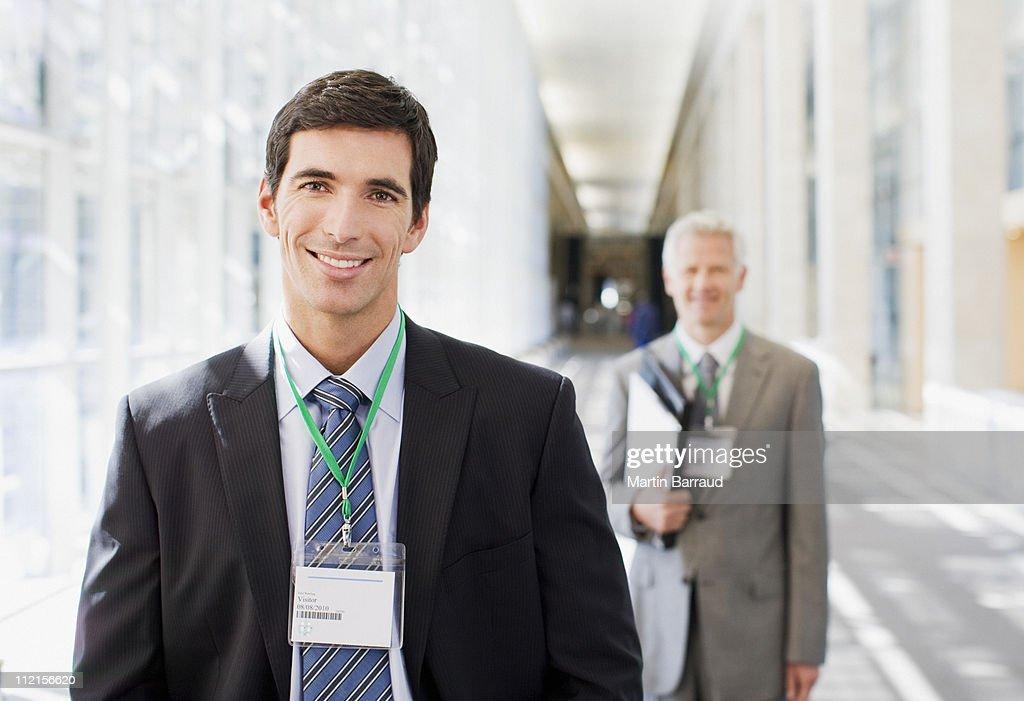 Businessmen standing in office