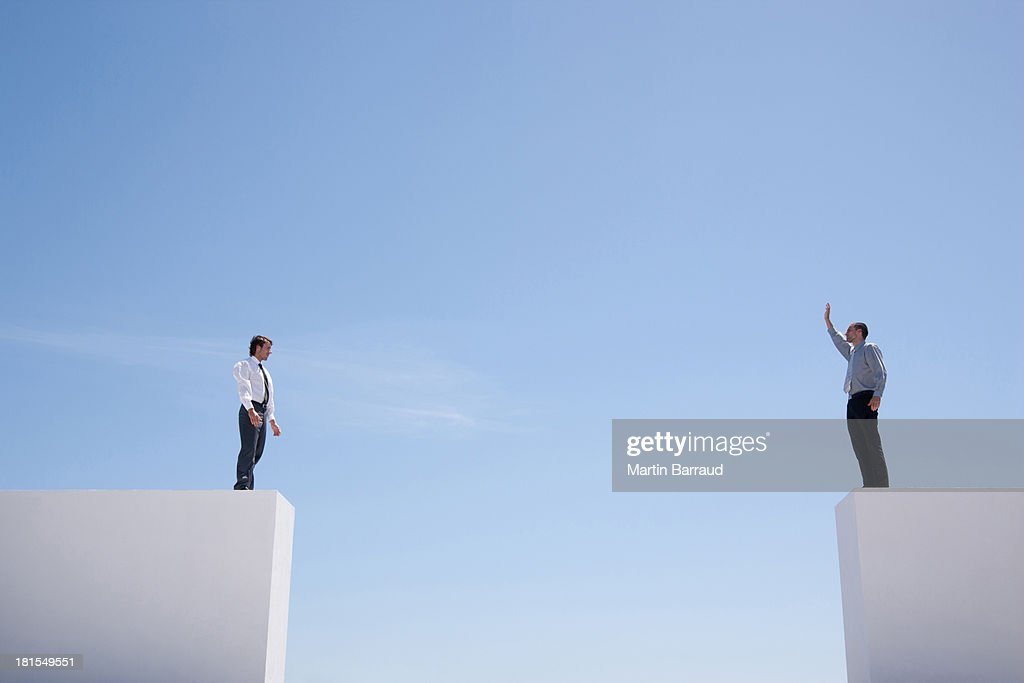 Businessmen standing on wall