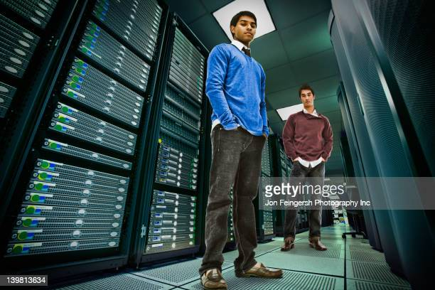 Businessmen standing together in server room