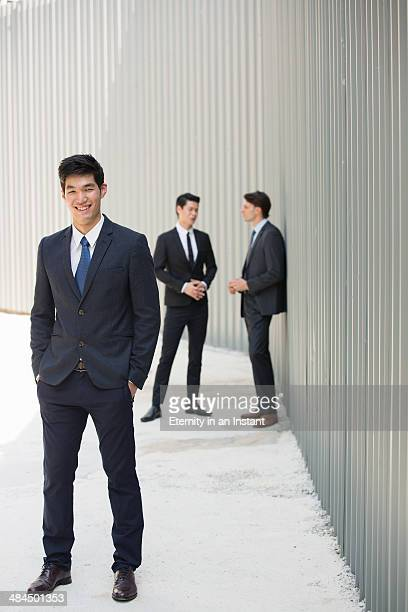 Businessmen standing together outdoors.
