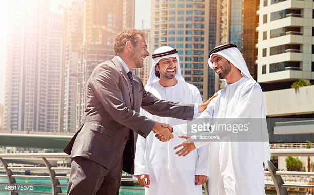 Businessmen struck a deal in Dubai.