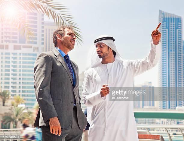 Businessmen struck a deal in Dubai.