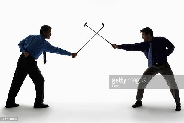 Businessmen Swordfighting with Golf Clubs