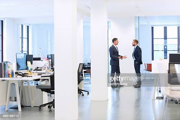 Businessmen talk at the office