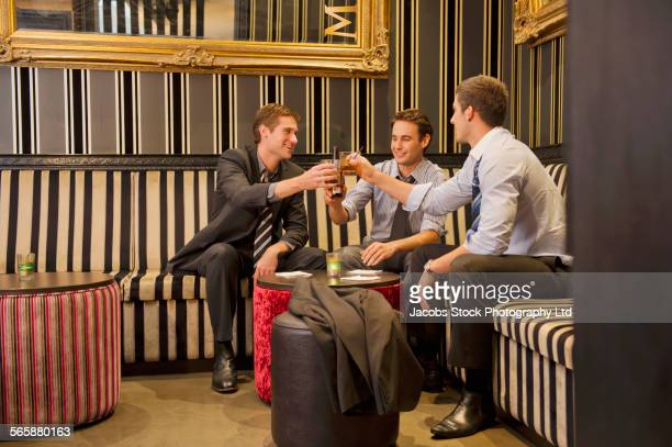 Businessmen talking and drinking in lounge