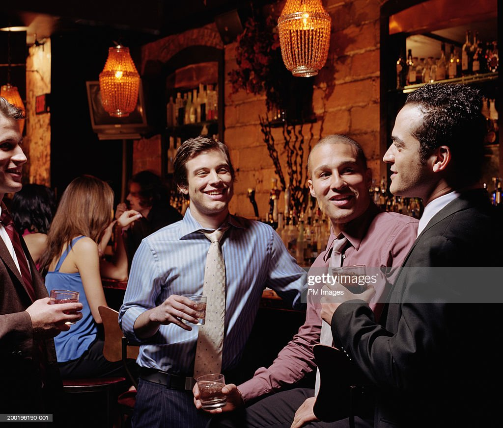 Businessmen talking at bar