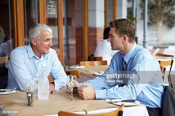 Businessmen talking at restaurant