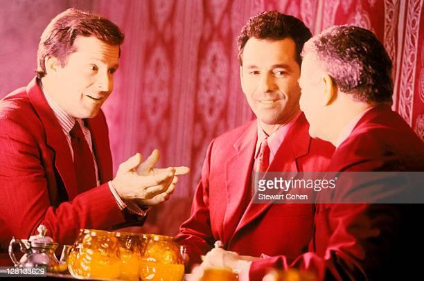 Businessmen talking in a bar