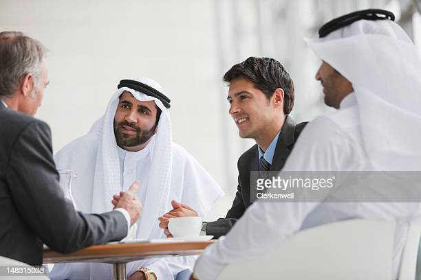 Businessmen talking in meeting