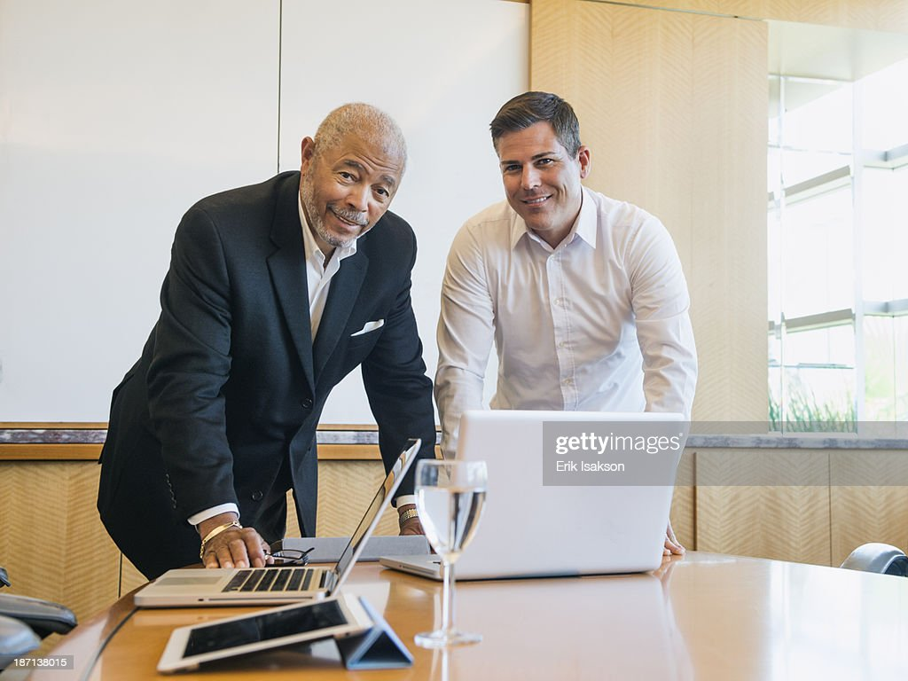 Businessmen talking in meeting : Stock Photo