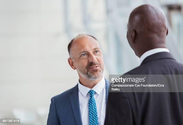 Businessmen talking in modern office