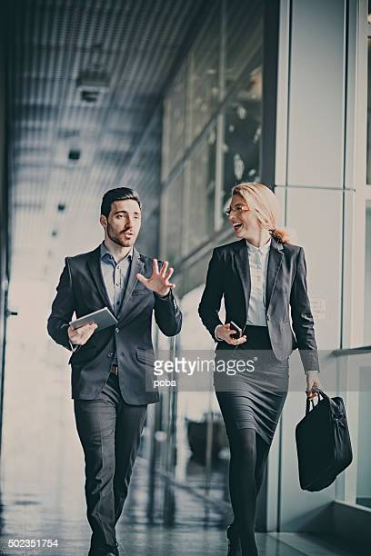 Businessmen talking in office hallway
