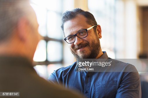 Businessmen talking in office : Stock Photo