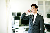 businessmen talking on a mobile in the office