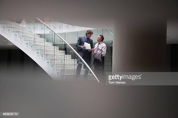 Businessmen talking on staircase