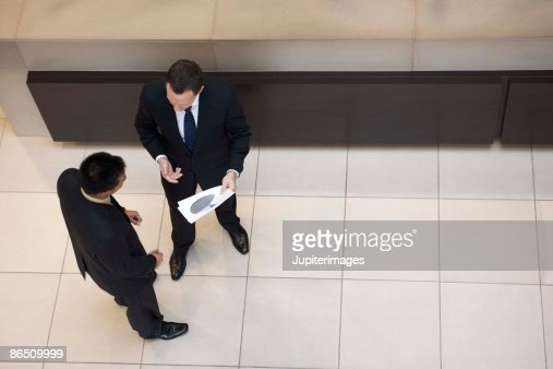 Businessmen talking : Stock Photo