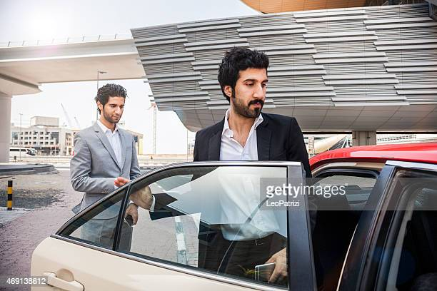 Businessmen travelling by taxi