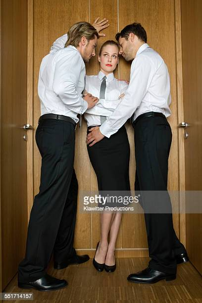 Businessmen Trying to Seduce Coworker
