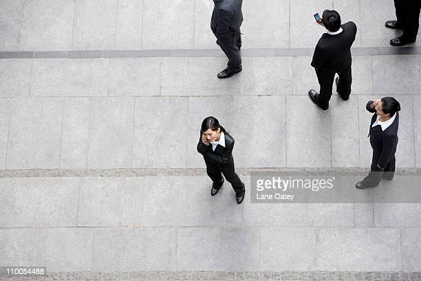Businessmen using cellphones