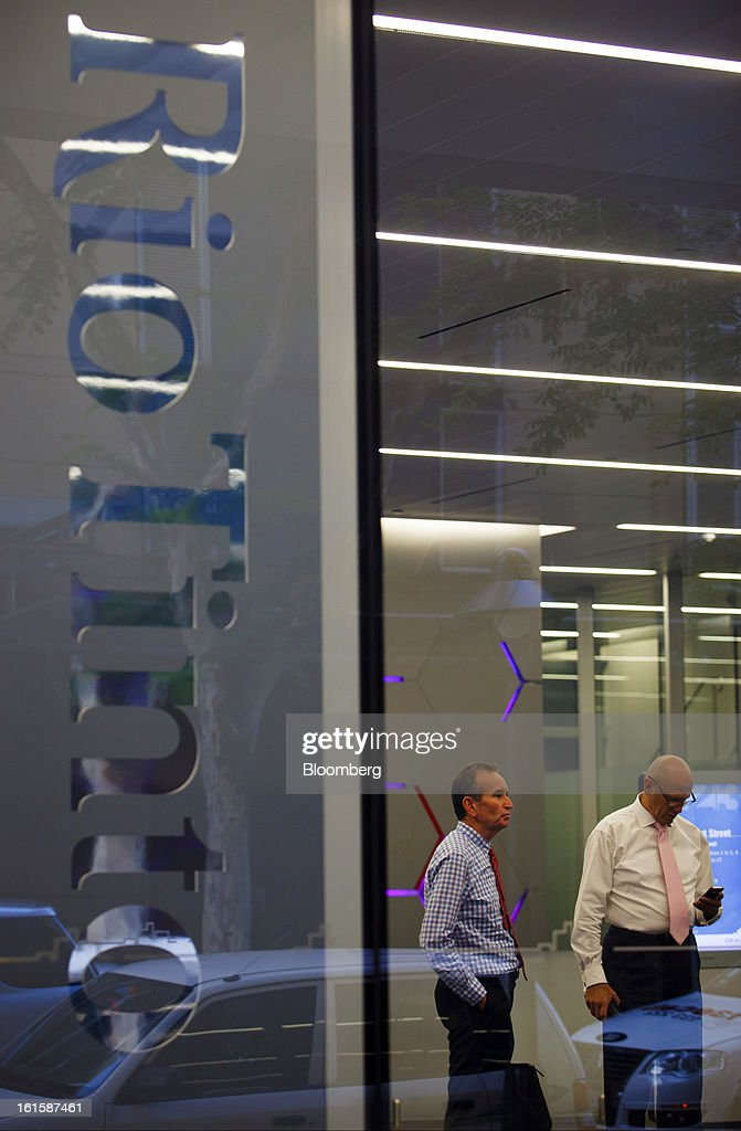 Businessmen wait in the foyer of the Rio Tinto Tower, which houses the offices of Rio Tinto Group, in Brisbane, Australia, on Tuesday, Feb. 12, 2013. Rio Tinto, the world's second-biggest mining company, is scheduled to announce full-year earnings on Feb. 14. Photographer: Patrick Hamilton/Bloomberg via Getty Images