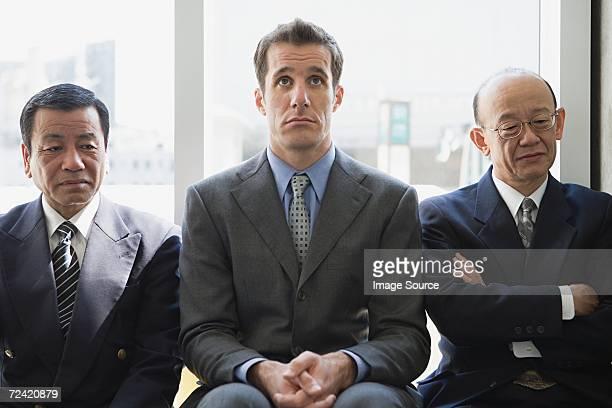 Businessmen waiting