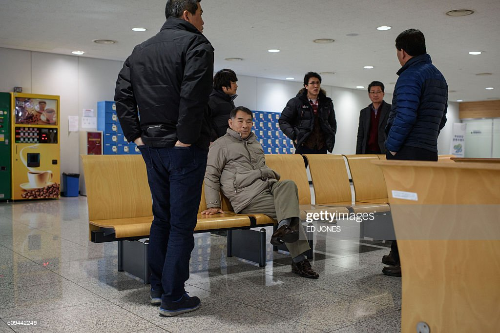 Businessmen waiting to re-enter the Kaesong joint industrial zone to retrieve their belongings wait at the CIQ immigration checkpoint in Paju on February 11, 2016. South Korea said it would suspend operations at the Kaesong joint industrial complex in North Korea to punish Pyongyang for its latest rocket launch and nuclear test. AFP PHOTO / Ed Jones / AFP / ED JONES