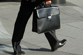 'Businessmen walking, holding briefcase'