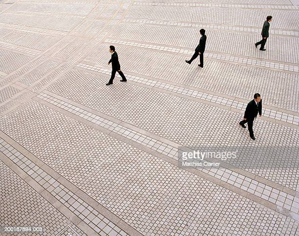 Businessmen walking in plaza, elevated view