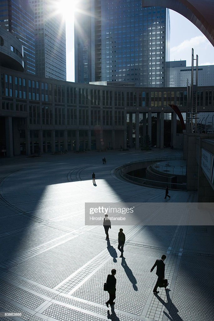 Businessmen walking in plaza,elevated view : Stock Photo