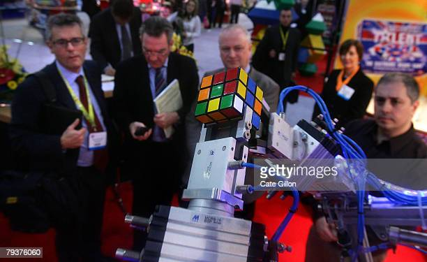 Businessmen watch Rubot 2 nicknamed the 'Cubinator' and invented by Peter Redmond work out the Rubiks cube in around 30 seconds on January 30 2008 in...