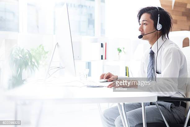 Businessmen who are handling the customer at the call center