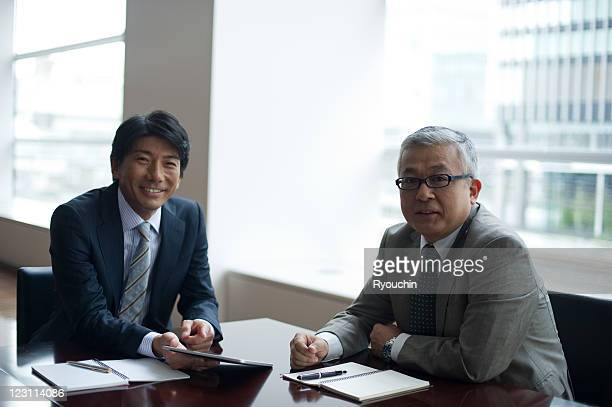 businessmen who works with tablet in office
