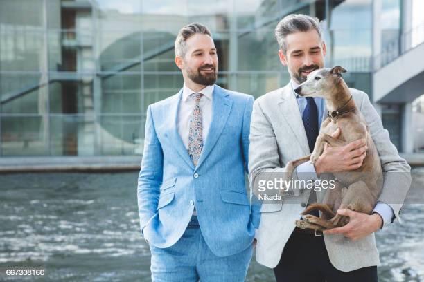 Businessmen with dog