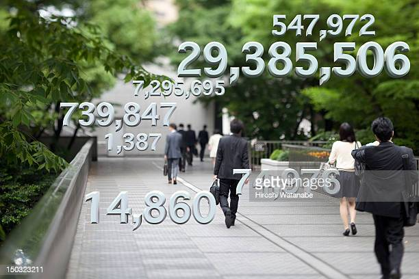 Businessmen with financial numbers