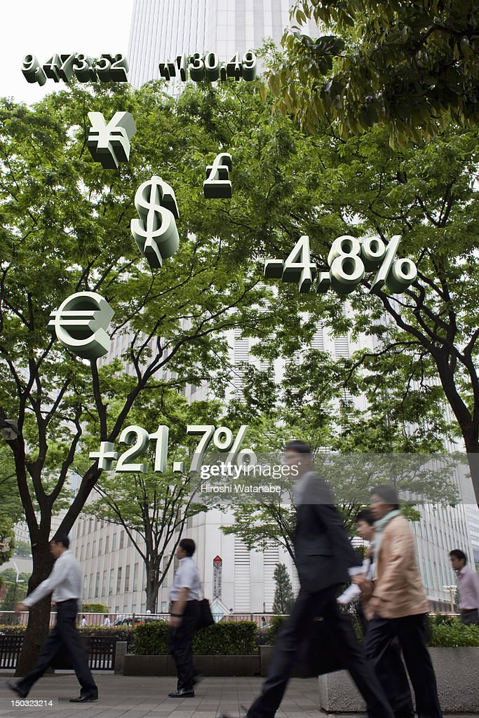Businessmen with financial numbers : Stock Photo