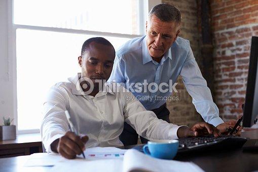 Businessmen Working On Computer In Office : Foto de stock