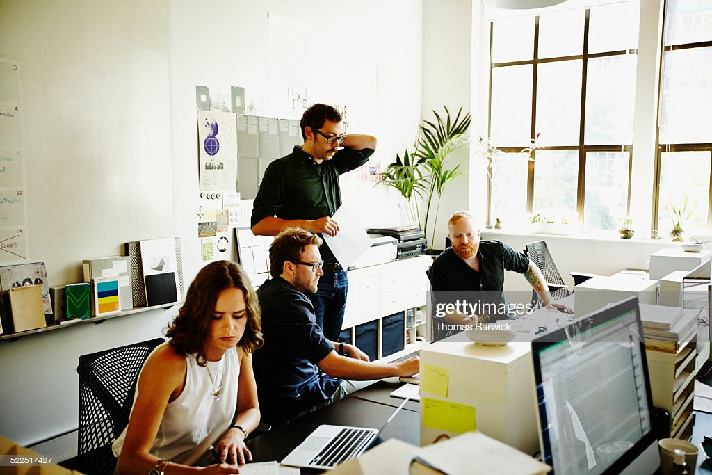 Businessmen working on project in startup office