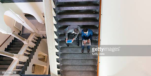 Businessmen working on the stairs