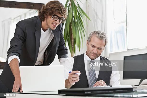 Businessmen working together at desk